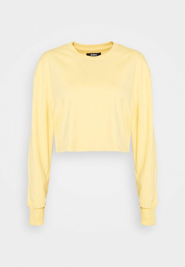 Botanical dyed top - Langarmshirt - light yellow