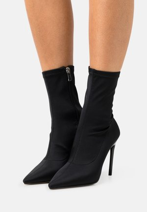 EASTON - Classic ankle boots - black