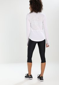 Under Armour - FLY FAST CAPRI - 3/4 sports trousers - black - 2