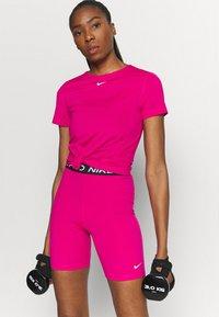 Nike Performance - ALL OVER - Camiseta básica - fireberry/white - 2