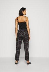 Fila Petite - WINTA CROPPED PANTS - Trousers - black - 2