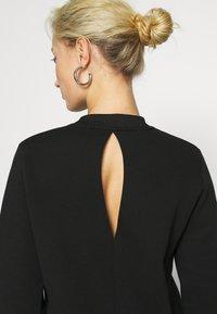 Calvin Klein Jeans - CUT OUT BACK DRESS - Day dress - black - 5