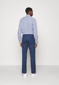 Polo Ralph Lauren - STRETCH SLIM FIT COTTON CHINO - Pantalon classique - rustic navy - 2