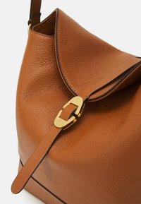 Coccinelle - JOSEPHINE - Handbag - caramel - 3