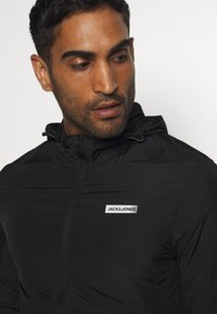 Jack & Jones Performance - JCOZSPORT JACKET - Training jacket - black - 5