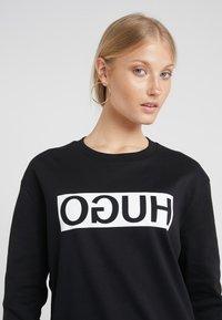 HUGO - NICCI - Sweatshirt - black - 4
