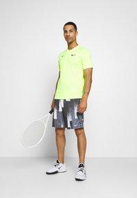 Nike Performance - DRY SHORT PRINT - Sports shorts - black/white - 1