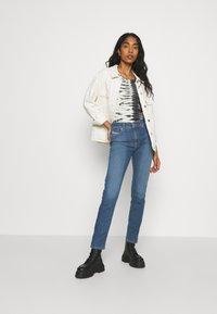 Diesel - ROISIN - Slim fit jeans - light blue - 1