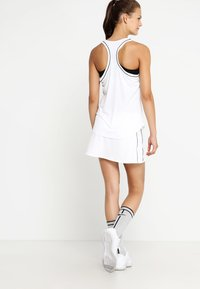 Nike Performance - DRY SKIRT - Sports skirt - white/black - 2