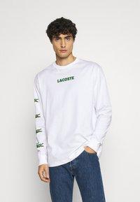Lacoste - T-shirt à manches longues - blanc - 0