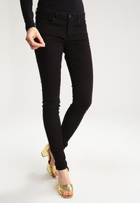 Levi's® - 711 SKINNY - Jeans Skinny Fit - black sheep - 0