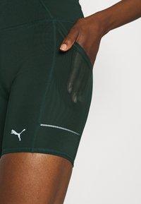 Puma - RUN FAVORITE SHORT - Legging - midnight green - 5