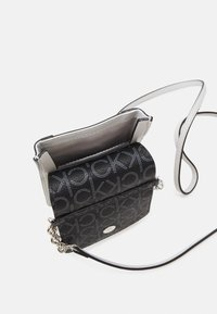 Calvin Klein - PHONE POUCH XBODY - Phone case - grey - 2