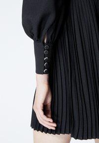 The Kooples - À DÉTAIL PLISSÉ - Day dress - black - 5