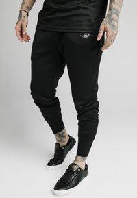 SIKSILK - SIKSILK TRANQUIL DUAL CUFF PANT - Pantaloni sportivi - black - 0