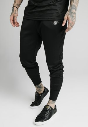 SIKSILK TRANQUIL DUAL CUFF PANT - Tracksuit bottoms - black