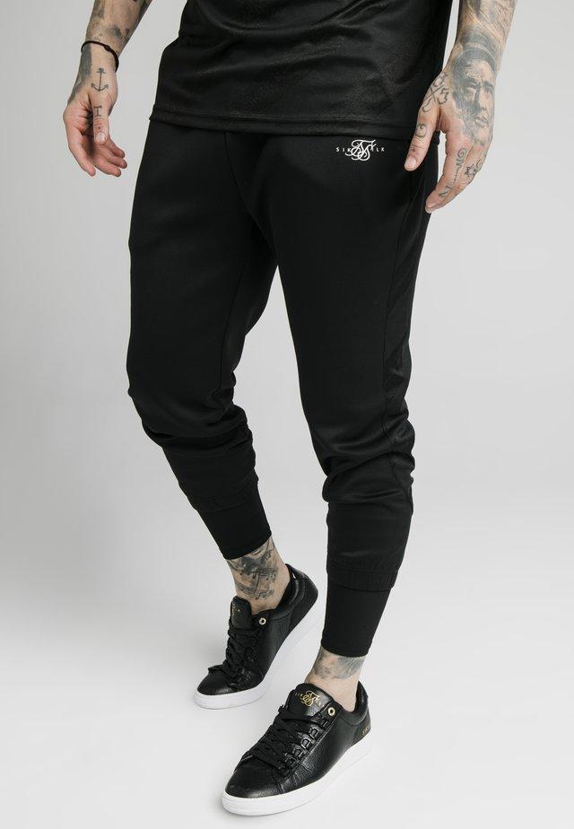SIKSILK TRANQUIL DUAL CUFF PANT - Teplákové kalhoty - black