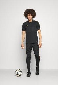 adidas Performance - TIRO PRIDE - Pantaloni sportivi - black - 1