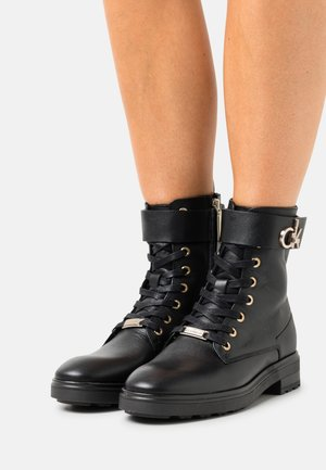 CLEAT BOOT - Lace-up ankle boots - black