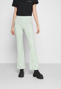 Monki - Pantalones - green melange - 0