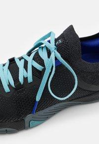 Under Armour - TRIBASE REIGN 3 - Sports shoes - black - 5