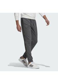 adidas Performance - COMOUFLAGE PT ESSENTIALS SPORTS REGULAR PANTS - Tracksuit bottoms - grey - 2