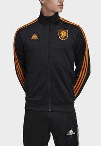 adidas Performance - NIEDERLANDE TRK JKT - Training jacket - black - 2