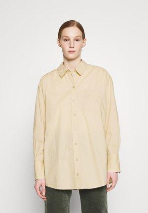 GIANNA - Camisa - beige