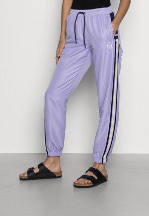 NOVIDA PANT - Tracksuit bottoms - purple