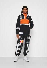 Ellesse - OLTUS TRACK PANT - Pantalones deportivos - black - 1