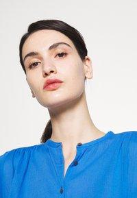 CLOSED - CHERRY - Button-down blouse - bluebird - 3