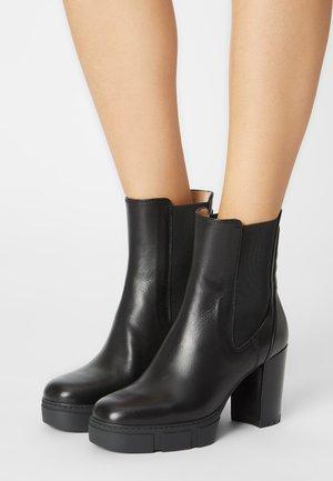 KUBEL - Kotníkové boty na platformě - black