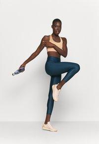 Casall - ICONIC SPORTS BRA - Medium support sports bra - clean beige - 1