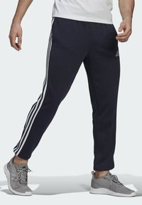 adidas Performance - ESSENTIALS FRENCH TERRY TAPERED 3-STRIPES JOGGERS - Træningsbukser - blue - 2