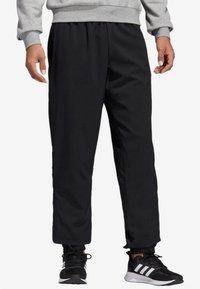 adidas Performance - ESSENTIALS PLAIN STANFORD TROUSERS - Spodnie treningowe - black - 0