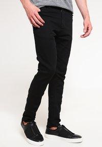 Samsøe Samsøe - TRAVIS  - Slim fit jeans - black rinse - 0