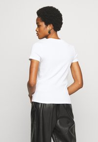 Monki - MAGDALENA TEE - T-shirts - white light solid