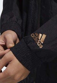 adidas Performance - U4U WINDBREAKER - Windbreaker - black - 5