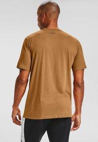 Under Armour - Print T-shirt - yellow ochre - 1