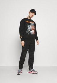 Carlo Colucci - FLAME - Sweatshirt - black - 1