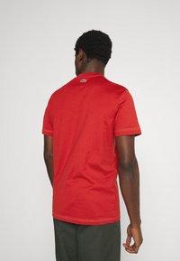 Lacoste - Print T-shirt - cinabre - 2