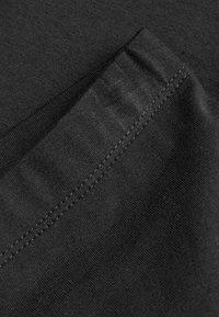 Next - Legíny - mottled black - 3