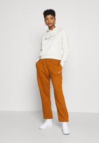 Nike Sportswear - PANT TREND - Tracksuit bottoms - tawny/white - 1