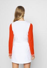 J.LINDEBERG - MELODY - Kardigan - tomato red/white - 2