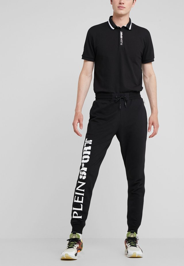 JOGGING TROUSERS STATEMENT - Träningsbyxor - black