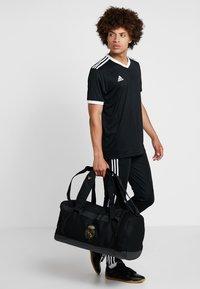 adidas Performance - REAL MADRID - Bolsa de deporte - black/dark gold - 1