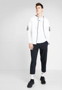 adidas Performance - 3STRIPES ATHLETICS SHORT SLEEVE TEE - Print T-shirt - white/black - 1