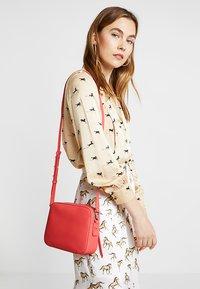 AllSaints - CAPTAIN LEA XBODY - Across body bag - coral pink - 1