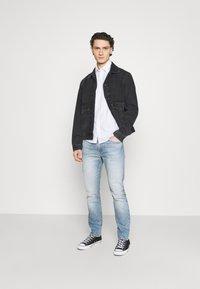 Levi's® - 502 TAPER - Jeans Tapered Fit - light indigo - 1