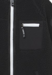 Levi's® - TRUCKER - Winter jacket - black - 2
